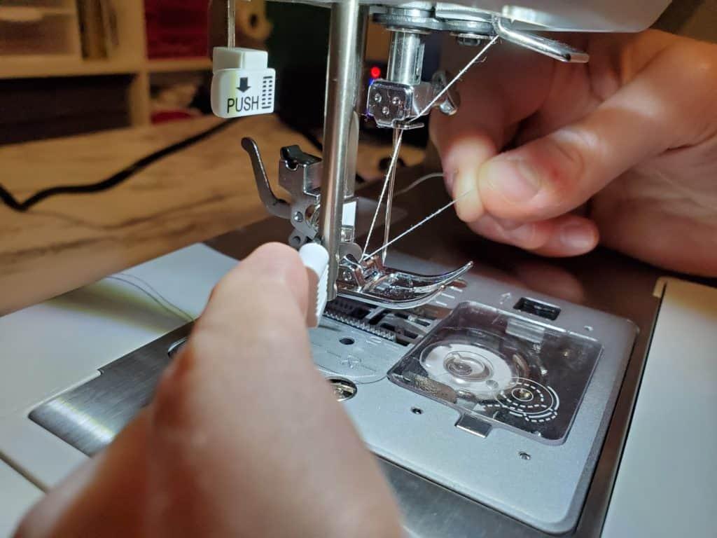 using the singer needle threader
