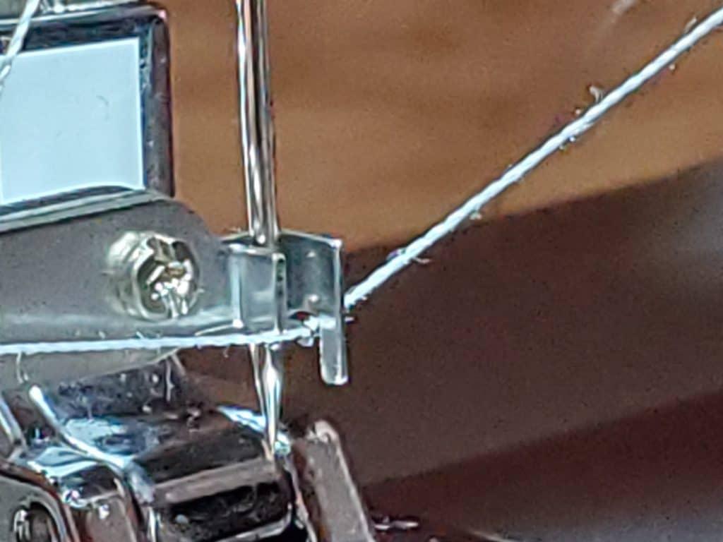 the hook on the singer auto needle threader