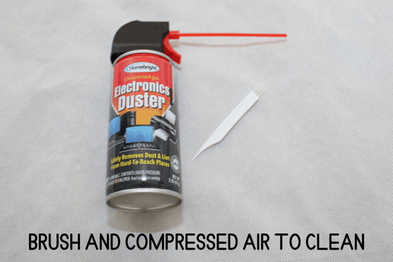 brush and compressed air to clean
