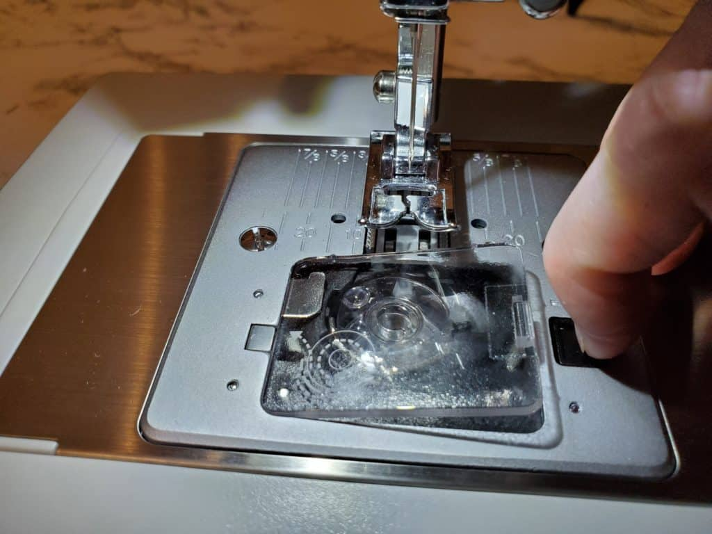 how to remove a singer heavy duty bobbin