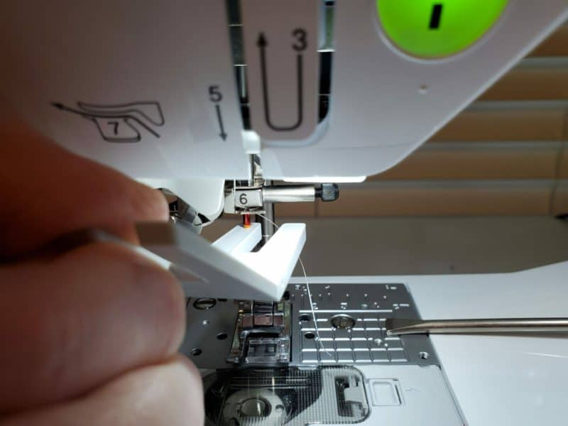 how to use the clearance plate to insert the sewing needle