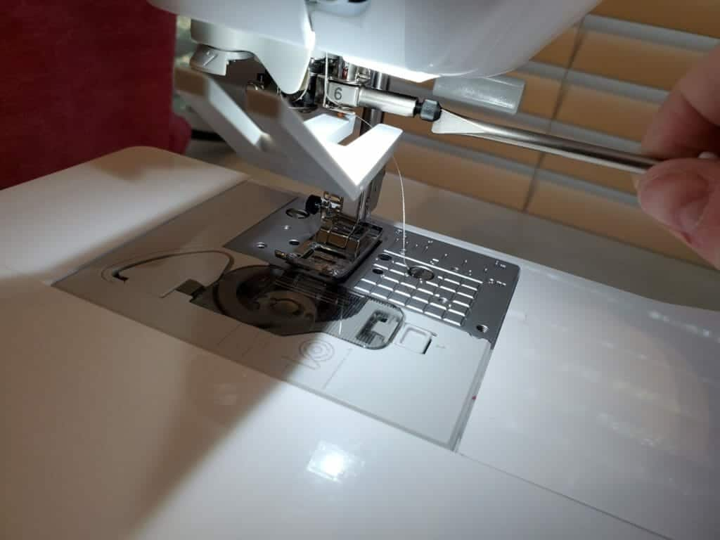tighten the screw back on the brother sewing machine