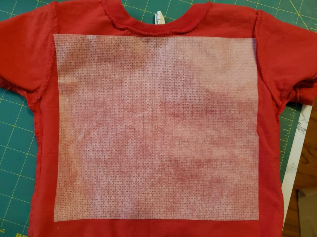place stabilizer on back of t-shirt to be embroidered