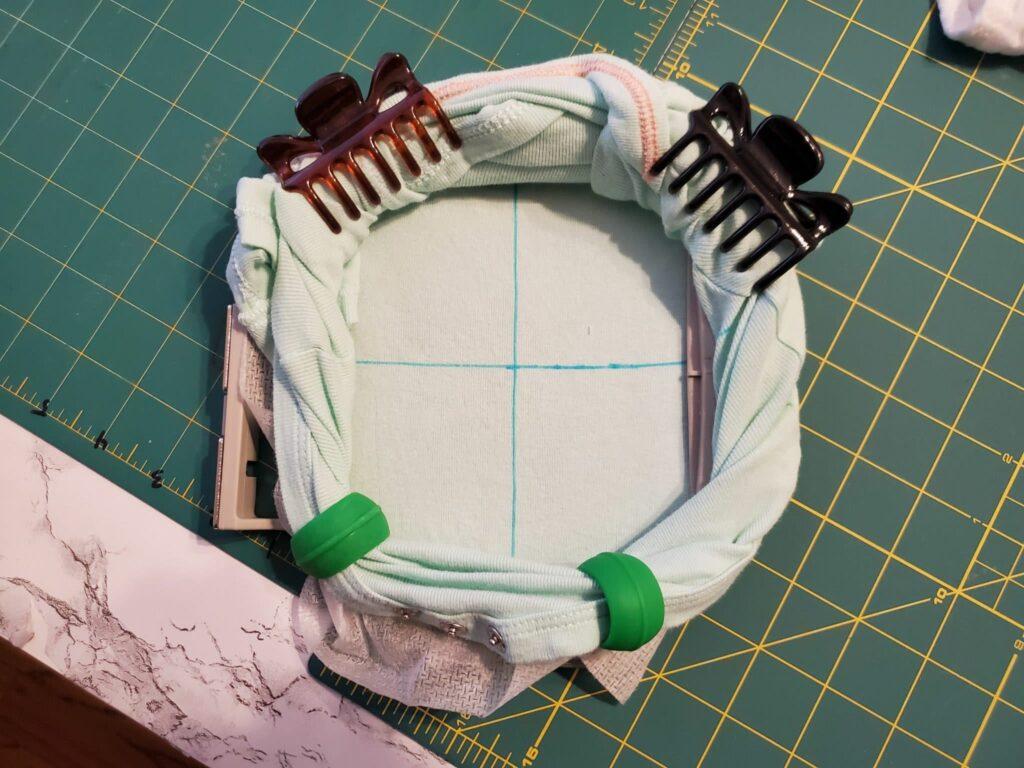how to get rid of excess fabric under hoop of onesie