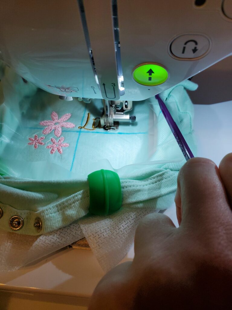how to keep fabric and clips from hitting embroidery needle arm
