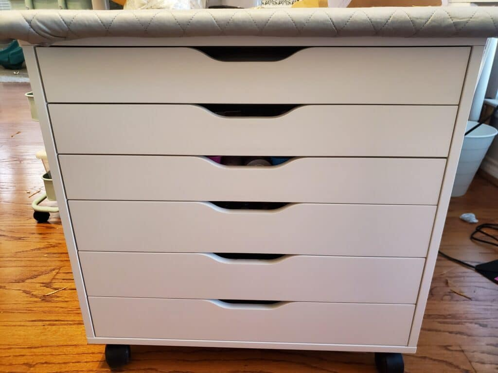 the IKEA Alex drawer with my ironing board on top