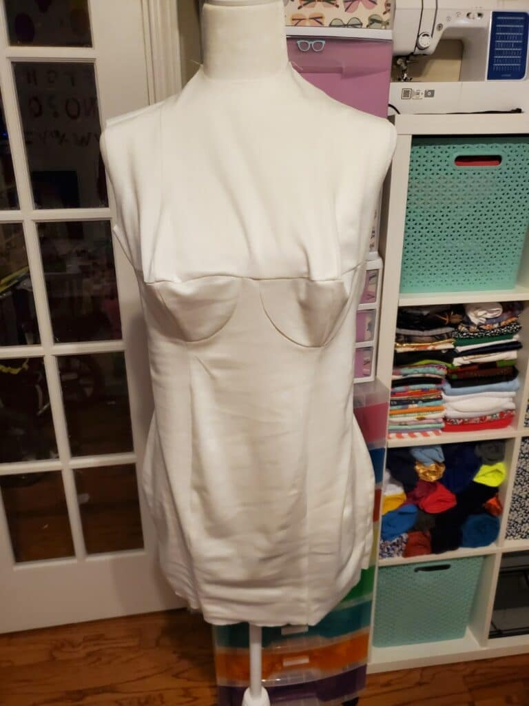 trying the dress form cover on the dress form