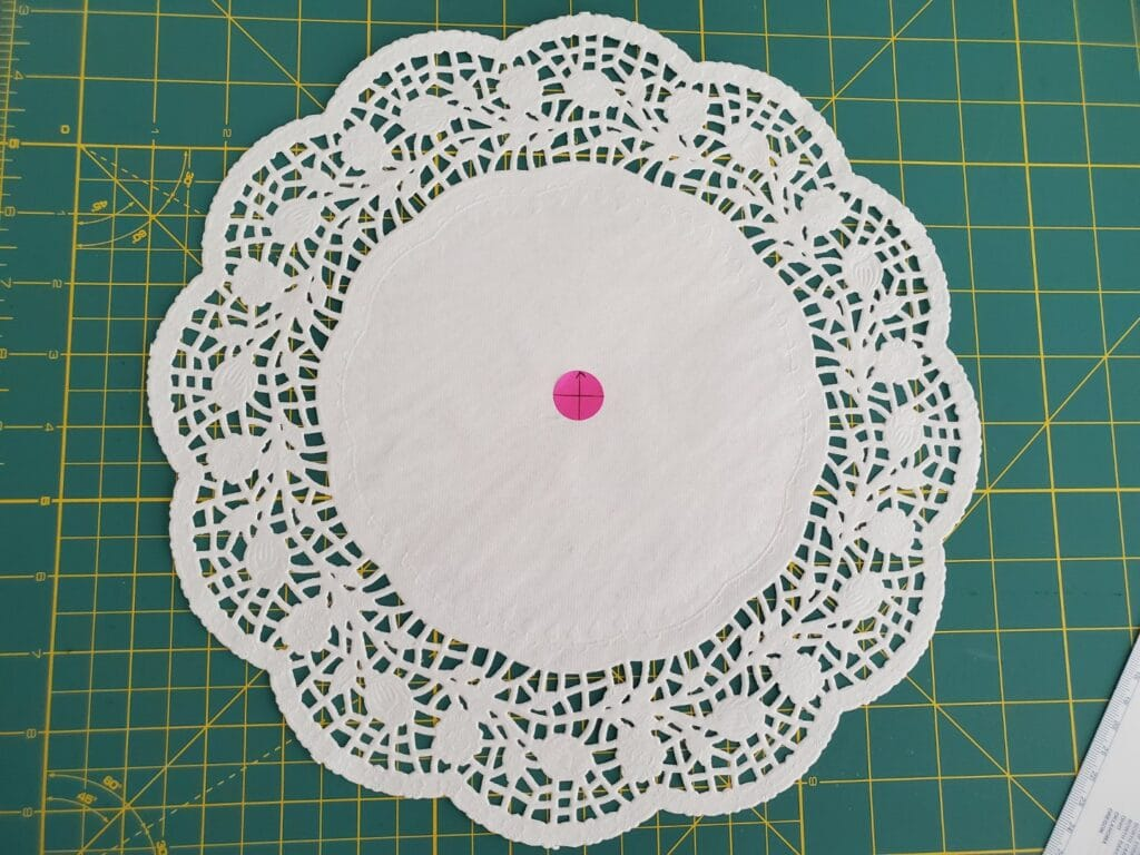 use a placement sticker to mark the doily