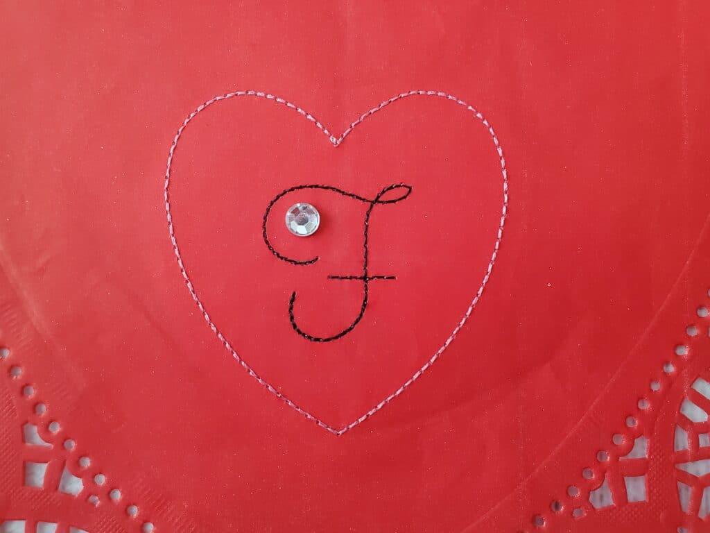running stitch heart on doily