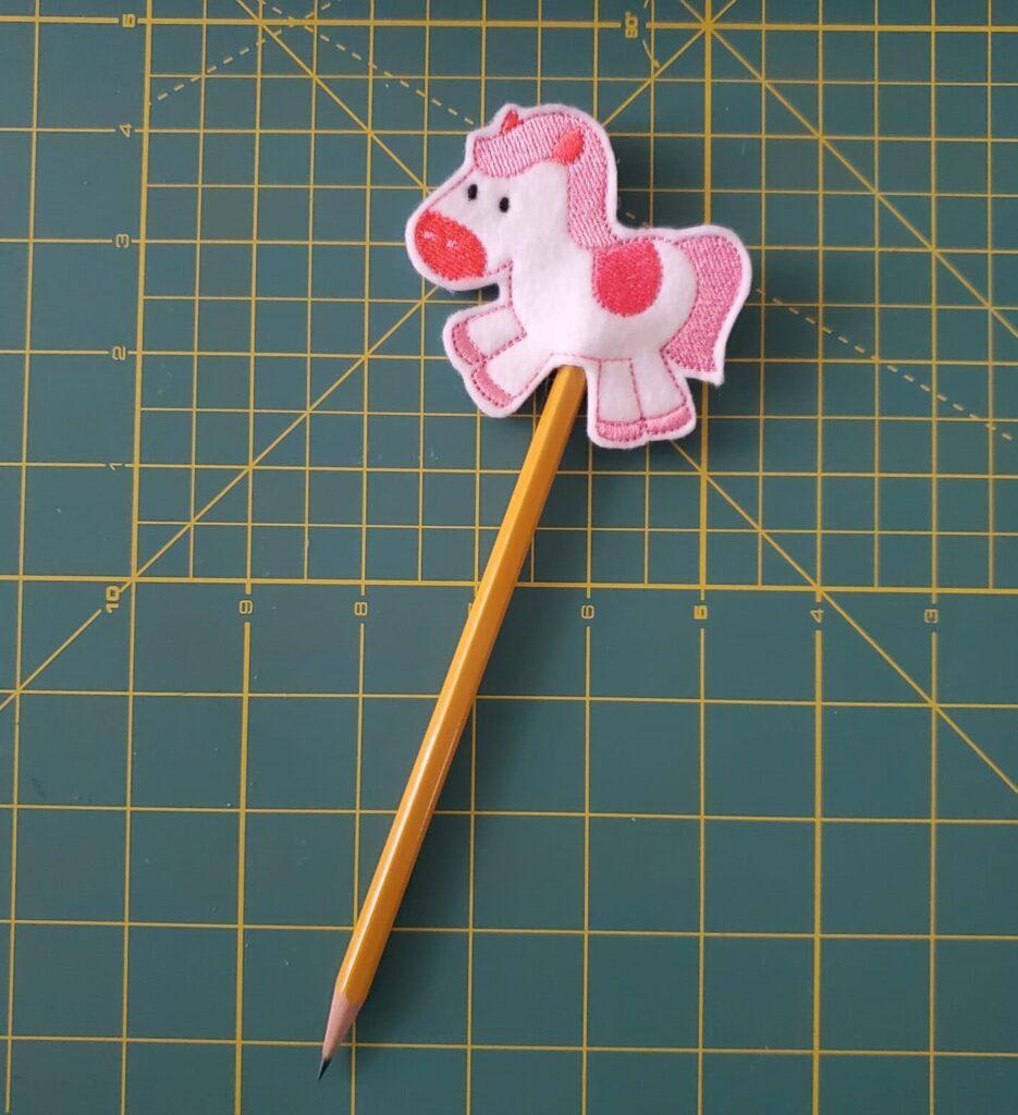 ith pencil topper
