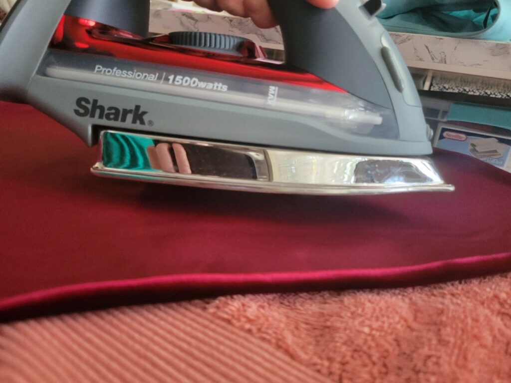 """hover .5"""" above velvet with steam iron"""